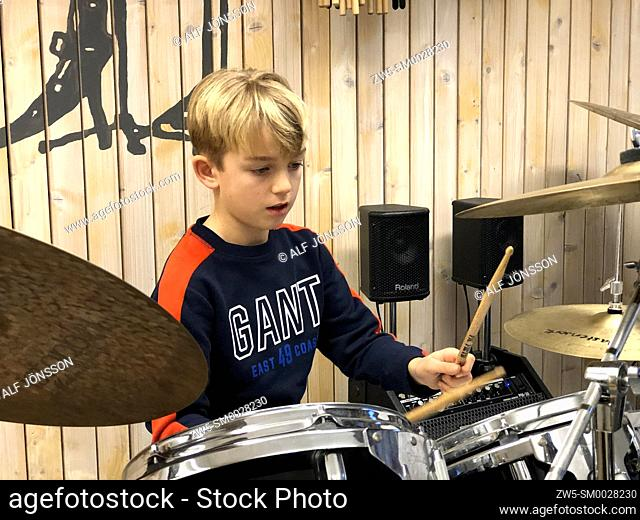 Boy, 10 years old, in a drumming lesson in Ystad, Sweden