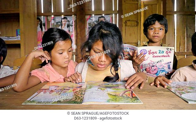 CAMBODIA. Katot village, inhabited by the Prov tribal group, Stung Treng district  Library and literacy building provided by DPA and SCIAF  Children reading...