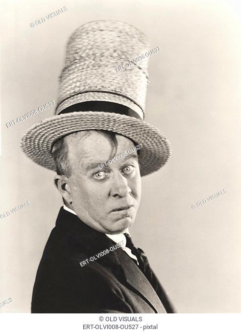 Man wearing stovepipe straw hat