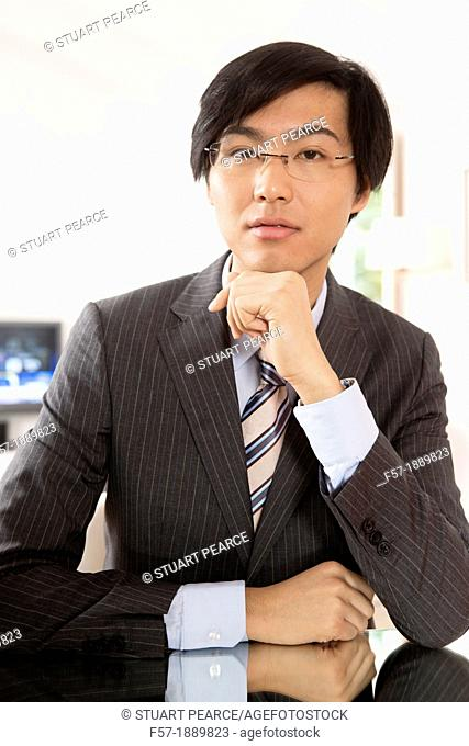 Expressive young Asian businessman
