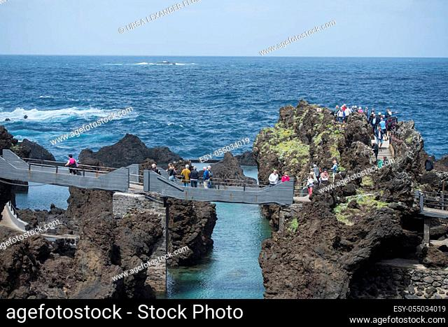 the Volcanic pools in the natural rocks on the coast at the Town Porto Moniz on the Island of Madeira in the Atlantic Ocean of Portugal