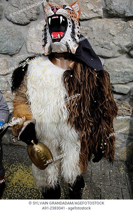 """Switzerland, Valais, Val d'Herens, village of Evolene, Carnaval, """"""""peluches"""""""" disguisment of young people and children dressed with a coat made of animal fur..."""