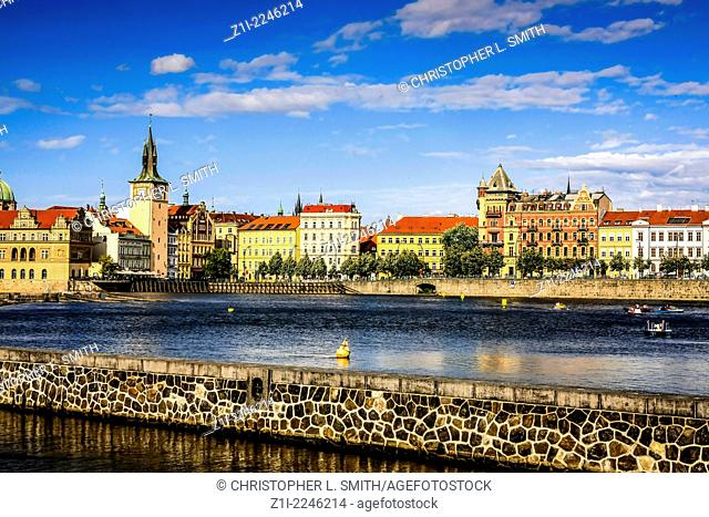 On the banks of the river Vltava in Prague on a summer afternoon