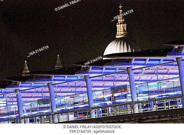 Dome of St. Paul's Cathedral seen behind Blackfriars Station lit up at night in London, England. This pictured recent extension of the station to the south bank...