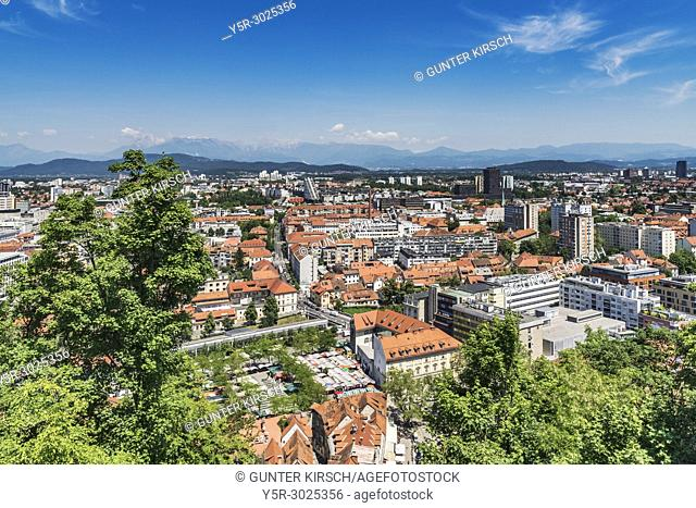 View over the capital city of Ljubljana. In the foreground are the marketplace and the Dragon bridge, Ljubljana, Slovenia, Europe
