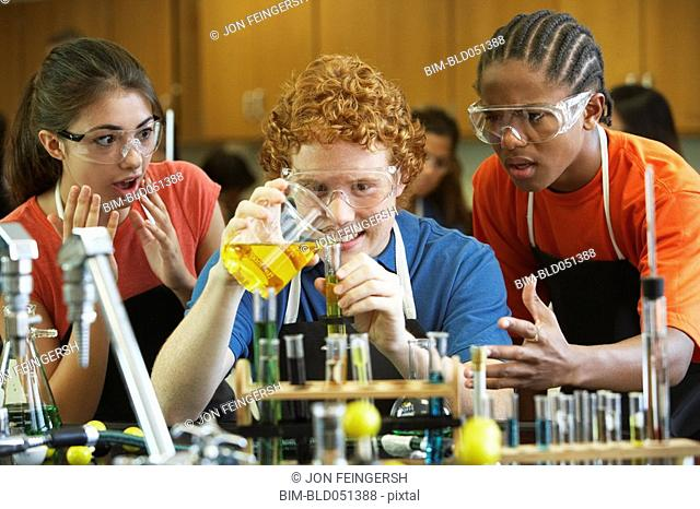 Multi-ethnic teenaged students in science class