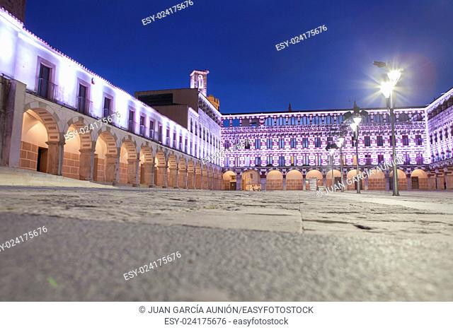 Hight square of Badajoz, illuminated by led lights at twilight. Low angle view from the floor