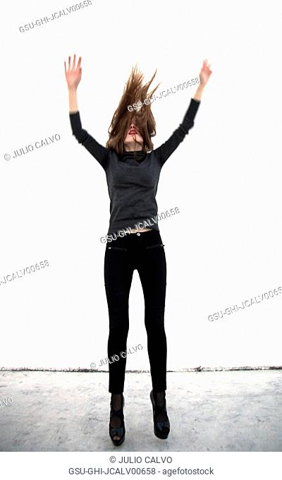 Young Adult Woman Jumping in Air