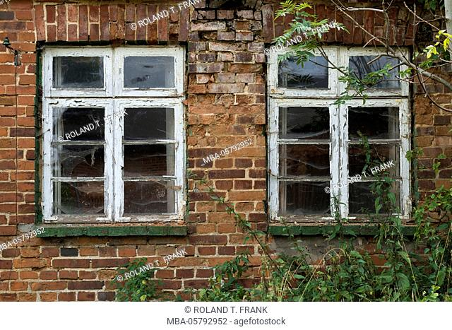 Germany, Mecklenburg-Western Pomerania, old facade with transom window close the Schloss Kittendorf