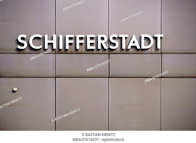 The name plate of the city Schifferstadt on the sheet metal facade of a station building
