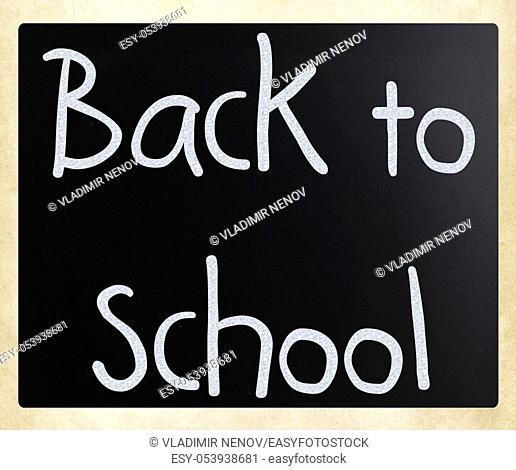 """""""""""""""""""""""Back to school"""""""" handwritten with white chalk on a blackboard"""
