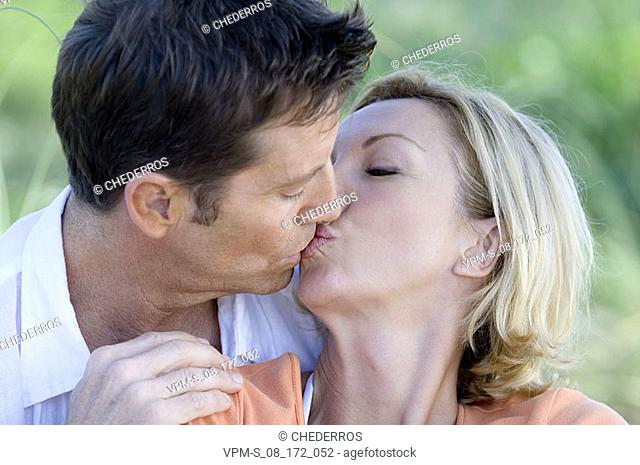Close-up of a mid adult couple kissing each other