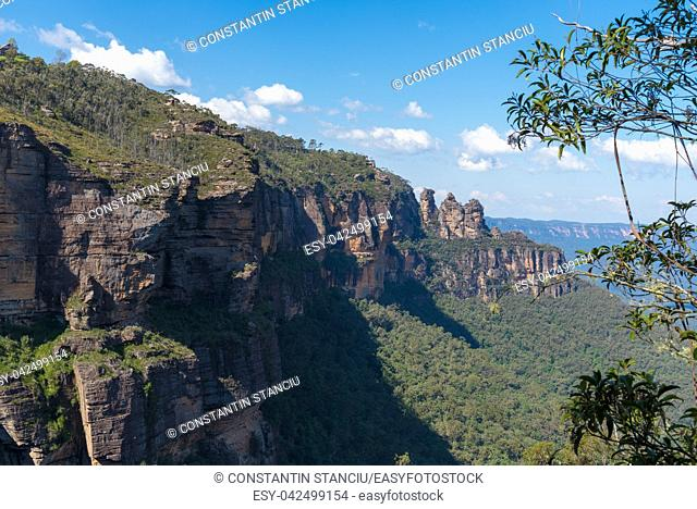 View over Jamison Valley and Three Sisters rock formation in Katoomba, Blue Mountains, New South Wales, Australia