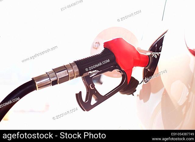 close up of gas gun with car
