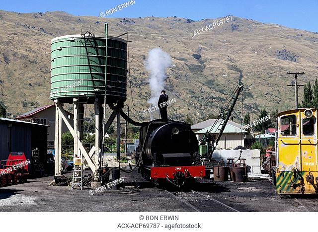 Loading water into a steam engine for the Kingston Flyer in Kingston, New Zealand