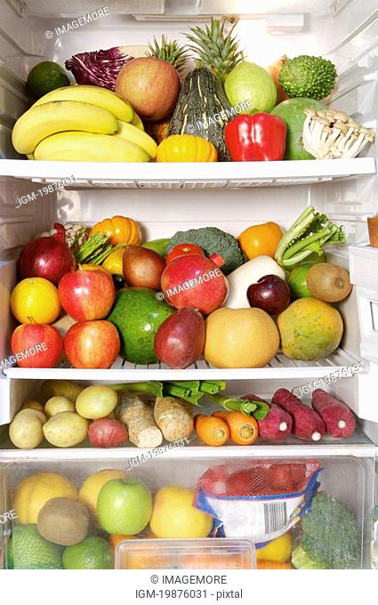Close-up of a stack of fruits and vegetables in the refrigerator