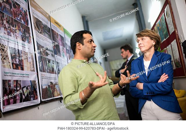 24 March 2018, India, New Delhi: Elke Buedenbender, wife of German President Steinmeier, visiting the NGOGoonj and being lead through the productions halls by...