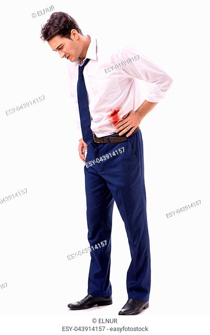 Wounded businessman with blood stains isolated on white background