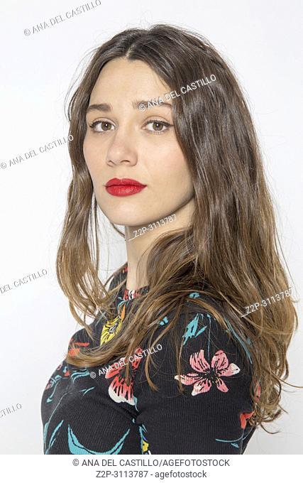 Studio shot of young beautiful woman. Upper body shot