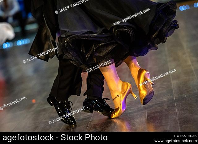Dancing shoes feet and legs of female and male couple ballroom
