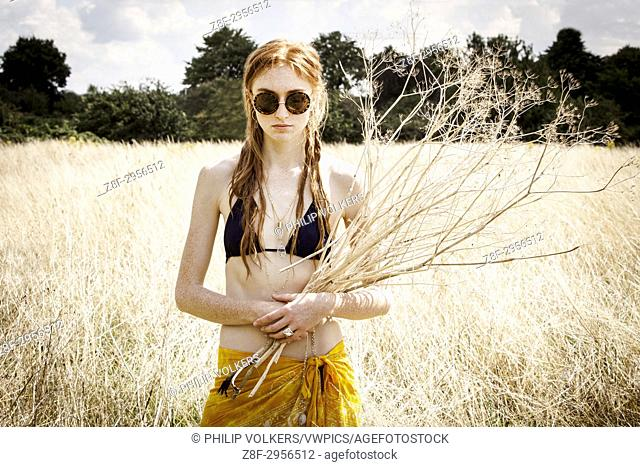 Ginger young woman fashion shoot on location