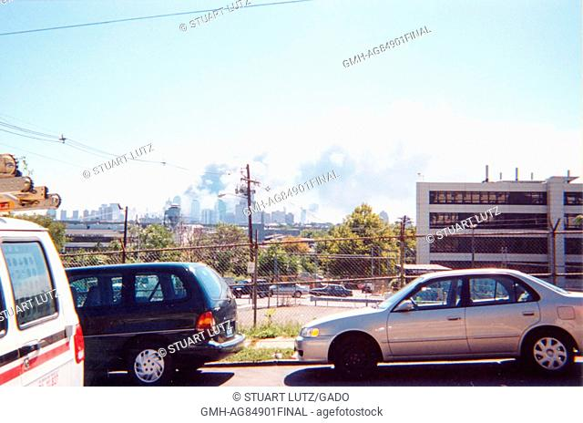 During the terrorist attacks of September 11, 2001, smoke is seen rising from the site of the World Trade Center, from Jersey City
