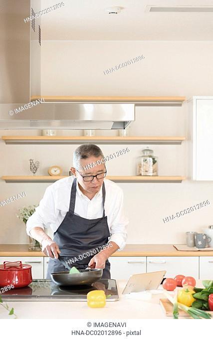 Scene of Senior man cooking