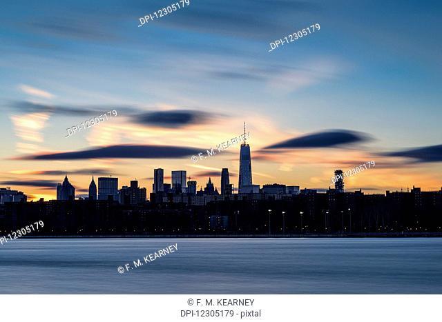 Sunset over Lower Manhattan and World Trade Center; New York City, New York, United States of America