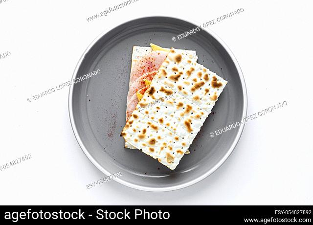 Salty crackers with sausage chicken, cheese and paprika from above on colors background. Flat lay. Top view