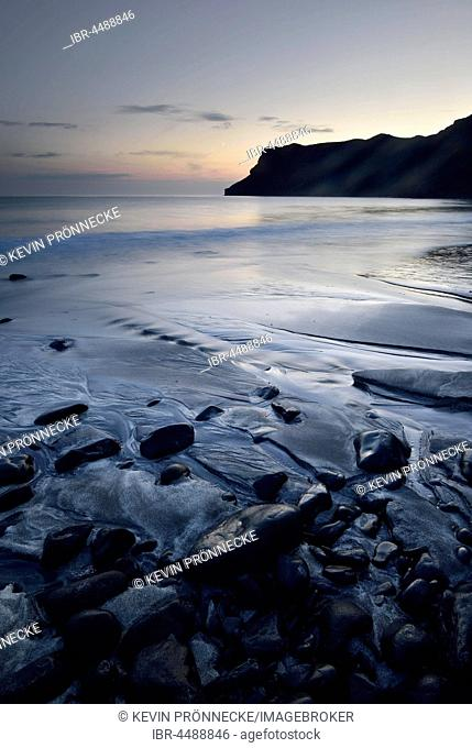 Stones in the sand on the beach of Talisker Bay, Isle of Skye, Scotland, United Kingdom