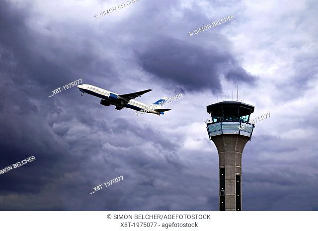 Air Traffic Control Tower with a Plane Taking Off. Luton Airport, UK
