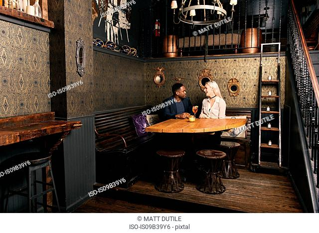 Couple sitting at table in pub