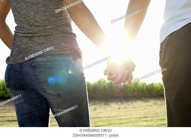 Couple holding hands taking walk together