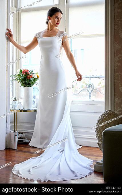 Bride trying on wedding dress in atelier of clothing designer, Bilbao, Spain
