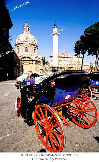 Carriage in front of the Trajan's Column and church of SS. Nome di Maria, Rome. Lazio, Italy