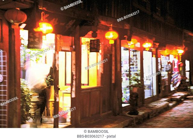 Shops decorated with illuminated Chinese lanterns, Lijiang City, Yunnan Province, People's Republic of China
