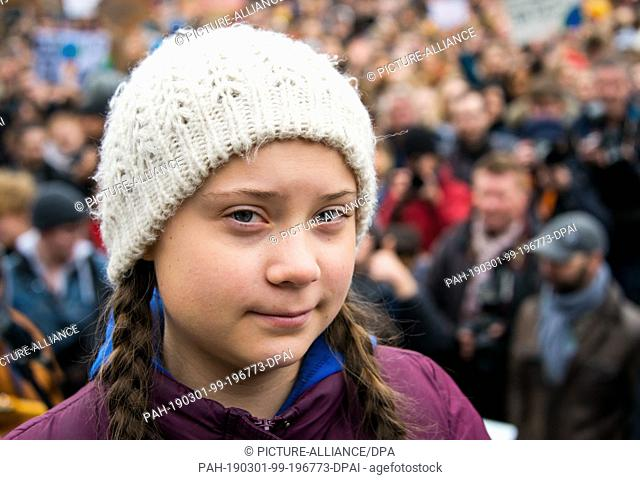 01 March 2019, Hamburg: Greta Thunberg, climate activist, stands before a rally on the Rathausmarkt in front of the Rathaus