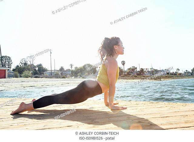 Young woman outdoors, in yoga position, Long Beach, California, USA