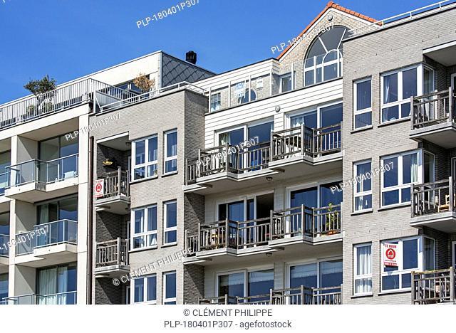 Modern flats / apartments / apartment block at seaside resort Zeebrugge / Zeebruges along the North Sea coast, West Flanders, Belgium