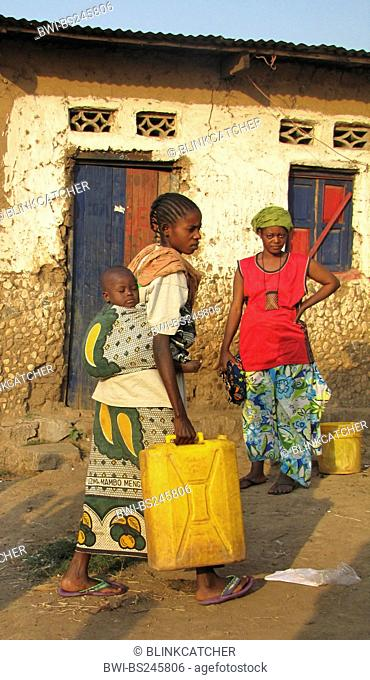 women at the poor area of the capital city taking water to their homes in canisters, baby is sleeping on its mother's back, Burundi, Bujumbura mairie, Buyenzi