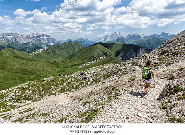 Italy, Trentino Alto Adige, Val di Fassa, Hiker on his way to the Dona Val from the Antermoia refuge