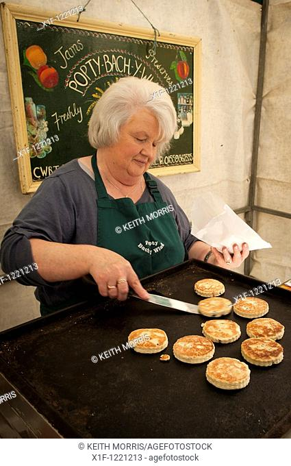 A woman cooking welsh cakes at Aberystwyth farmers market and food festival September 2010, Wales UK