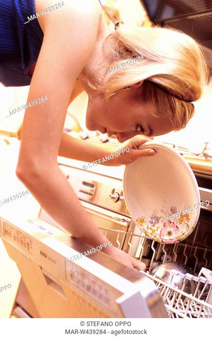 woman filling the dishwasher
