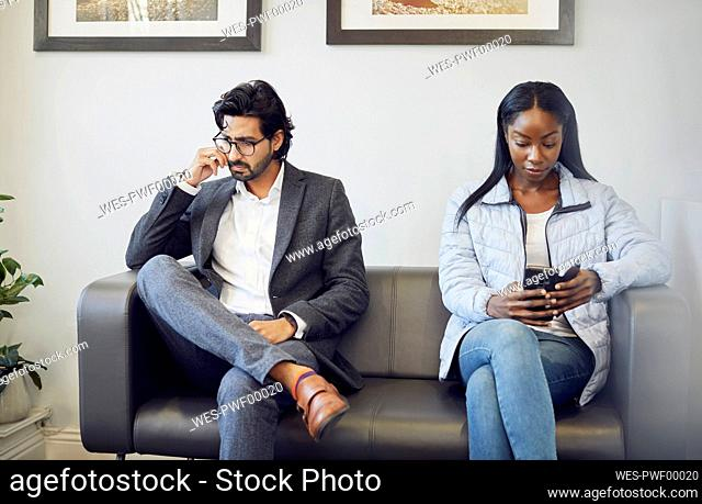 Two patients in waiting room of a medical practice