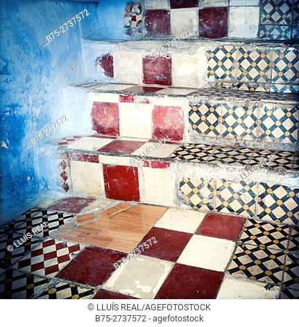 Hydraulic tiles on stair with blue wall. Chauen, Morocco