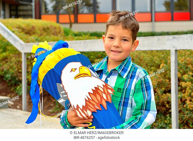 Boy, 6 years, first day at school with school cone, portrait, Germany