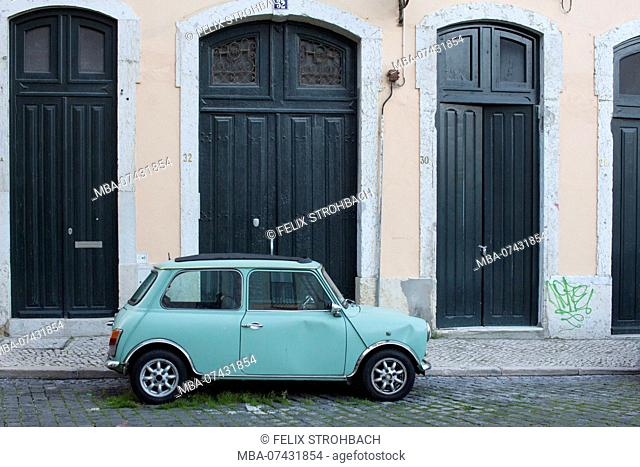 Small light blue car on the roadside in Lisbon