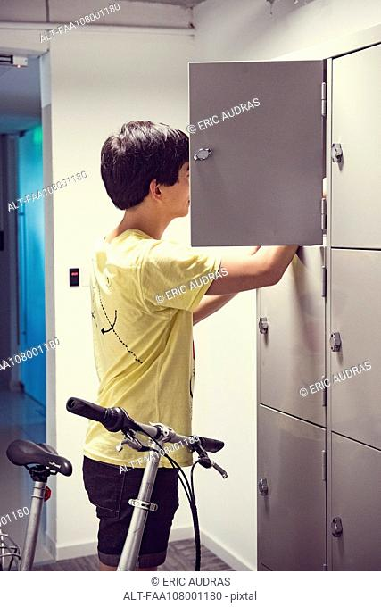 Student looking for something in locker
