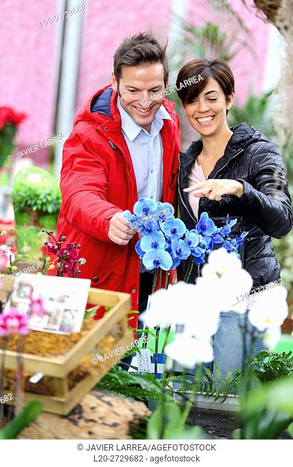 Couple buying orchids, Garden center