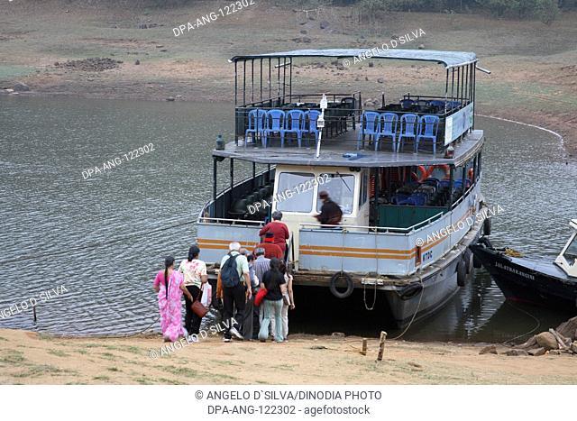 Early morning tourists going toward boat Jetty for boat ride at Periyar lake ; Periyar wildlife sanctuary ; Thekkady ; Kerala ; India